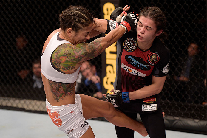 GOIANIA, BRAZIL - MAY 30:  Juliana Lima of Brazil (L) and  Ericka Almeida of Brazil exchange punches in their UFC strawweight bout during the UFC Fight Night Condit v Alves at Arena Goiania on May 30, 2015 in Goiania.  (Photo by Buda Mendes/Zuffa LLC/Zuff