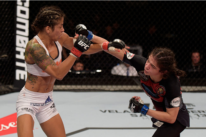 GOIANIA, BRAZIL - MAY 31: Ericka Almeida of Brazil punches Juliana Lima of Brazil in their UFC strawweight bout during the UFC Fight Night Condit v Alves at Arena Goiania on May 30, 2015 in Goiania.   (Photo by Buda Mendes/Zuffa LLC/Zuffa LLC via Getty Im