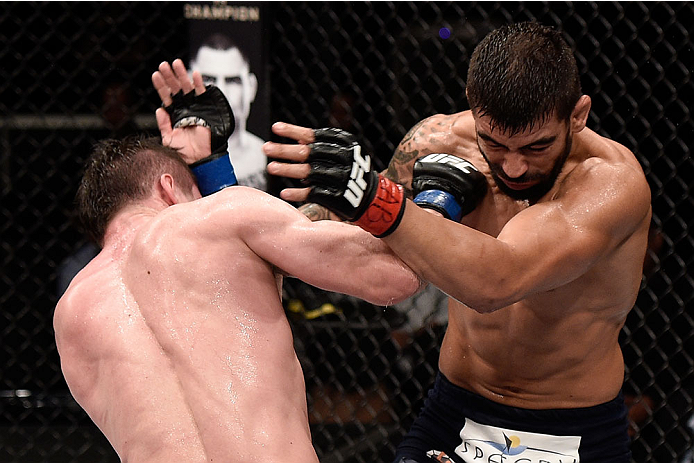 GOIANIA, BRAZIL - MAY 30:  Nicolas Dalby of Denmark punches Elizeu Zaleski dos Santos of Brazil in their welterweight UFC bout during the UFC Fight Night Condit v Alves at Arena Goiania on May 30, 2015 in Goiania.  (Photo by Buda Mendes/Zuffa LLC/Zuffa LL