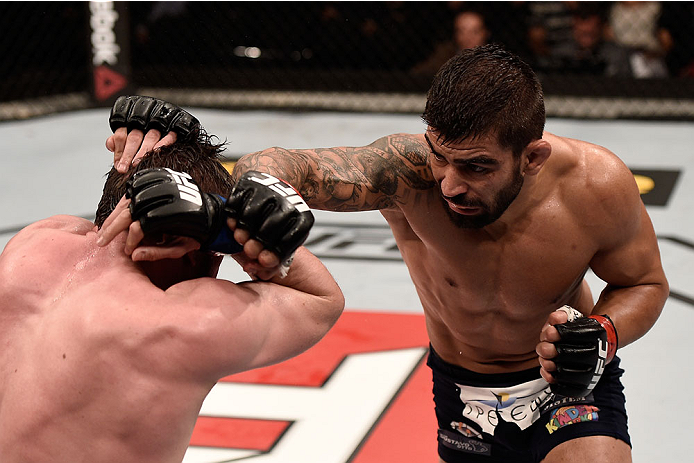 GOIANIA, BRAZIL - MAY 30:  Elizeu Zaleski dos Santos of Brazil punches Nicolas Dalby of Denmark in their welterweight UFC bout during the UFC Fight Night Condit v Alves at Arena Goiania on May 30, 2015 in Goiania.  (Photo by Buda Mendes/Zuffa LLC/Zuffa LL