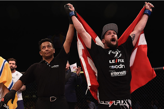 GOIANIA, BRAZIL - MAY 30:  Nicolas Dalby of Denmark celebrates his victory over Elizeu Zaleski dos Santos of Brazil in their welterweight UFC bout during the UFC Fight Night Condit v Alves at Arena Goiania on May 30, 2015 in Goiania.  (Photo by Buda Mende