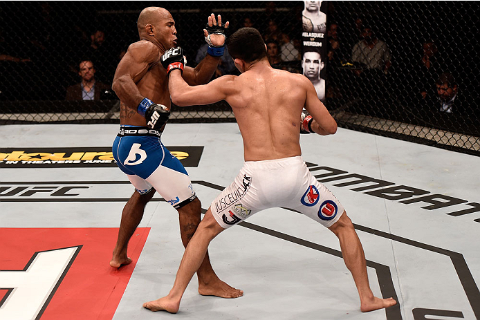 GOIANIA, BRAZIL - MAY 30:  Jussier Formiga of Brazil punches Wilson Reis of Brazil in their UFC flyweight bout during the UFC Fight Night Condit v Alves at Arena Goiania on May 30, 2015 in Goiania.  (Photo by Buda Mendes/Zuffa LLC/Zuffa LLC via Getty Imag
