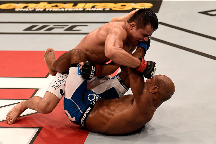 GOIANIA, BRAZIL - MAY 31: Jussier Formiga of Brazil punches Wilson Reis of Brazil in their UFC flyweight bout during the UFC Fight Night Condit v Alves at Arena Goiania on May 30, 2015 in Goiania.   (Photo by Buda Mendes/Zuffa LLC/Zuffa LLC via Getty Imag
