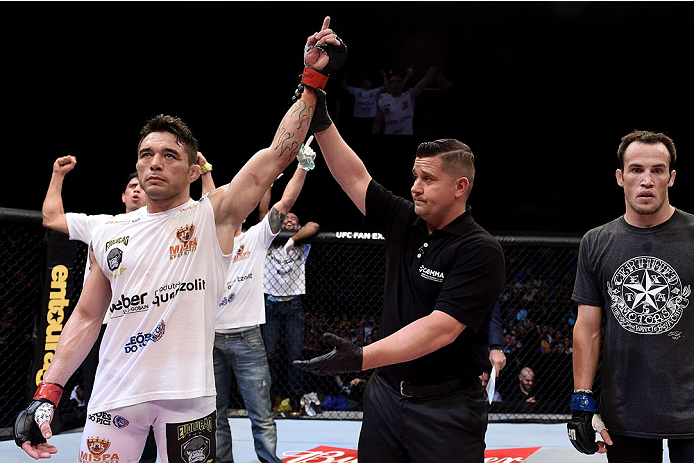 GOIANIA, BRAZIL - MAY 30:  Rony Jason of Brazil celebrates victory by submission over Damon Jackson of the United States in their UFC featherweight bout during the UFC Fight Night Condit v Alves at Arena Goiania on May 30, 2015 in Goiania.  (Photo by Buda