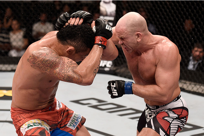 GOIANIA, BRAZIL - MAY 30:  Ryan Jimmo of Canada punches Francimar Barroso of Brazil in their light heavyweight UFC bout during the UFC Fight Night event at Arena Goiania on May 30, 2015 in Goiania.  (Photo by Buda Mendes/Zuffa LLC/Zuffa LLC via Getty Imag