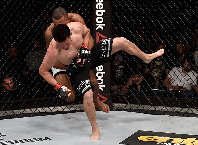 GOIANIA, BRAZIL - MAY 30:  Alex Oliveira of Brazil attempts a submission over KJ Noons of the United States in their welterweight UFC bout during the UFC Fight Night event at Arena Goiania on May 30, 2015 in Goiania.  (Photo by Buda Mendes/Zuffa LLC/Zuffa