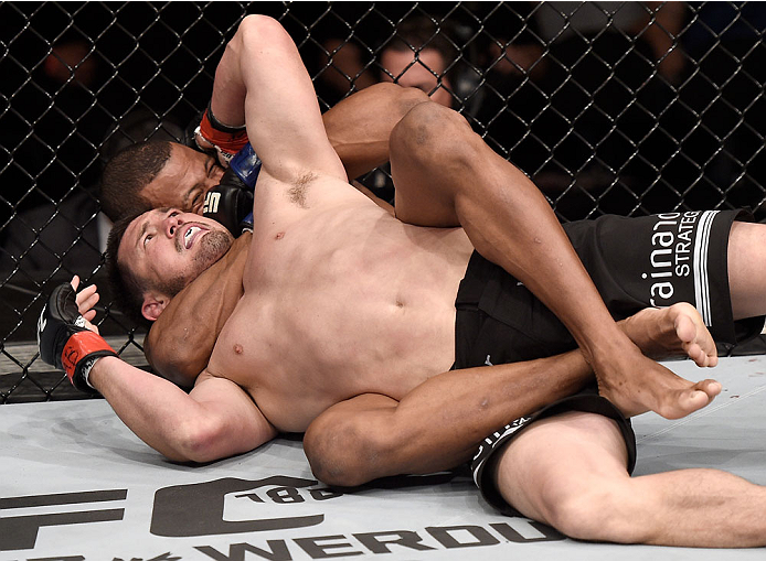GOIANIA, BRAZIL - MAY 30:  Alex Oliveira of Brazil submits KJ Noons of the United States in their welterweight UFC bout during the UFC Fight Night event at Arena Goiania on May 30, 2015 in Goiania.  (Photo by Buda Mendes/Zuffa LLC/Zuffa LLC via Getty Imag