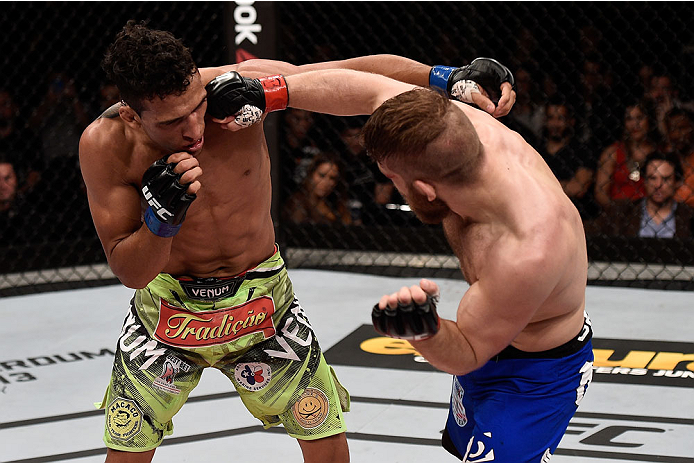 GOIANIA, BRAZIL - MAY 31:  Nick Lentz of the United States punches Charles Oliveira of Brazil in their featherweight UFC bout during the UFC Fight Night event at Arena Goiania on May 30, 2015 in Goiania, Brazil.   (Photo by Buda Mendes/Zuffa LLC/Zuffa LLC