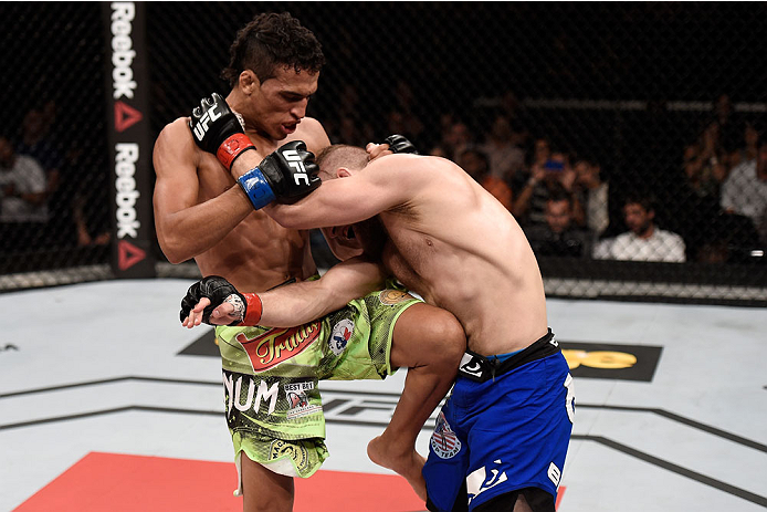 GOIANIA, BRAZIL - MAY 30:  Charles Oliveira kicks Nick Lentz of the United States in their featherweight UFC bout during the UFC Fight Night event at Arena Goiania on May 30, 2015 in Goiania, Brazil.  (Photo by Buda Mendes/Zuffa LLC/Zuffa LLC via Getty Im