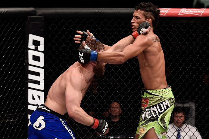 GOIANIA, BRAZIL - MAY 30:  Nick Lentz of the United States punches Charles Oliveira of Brazil in their featherweight UFC bout during the UFC Fight Night event at Arena Goiania on May 30, 2015 in Goiania, Brazil.  (Photo by Buda Mendes/Zuffa LLC/Zuffa LLC