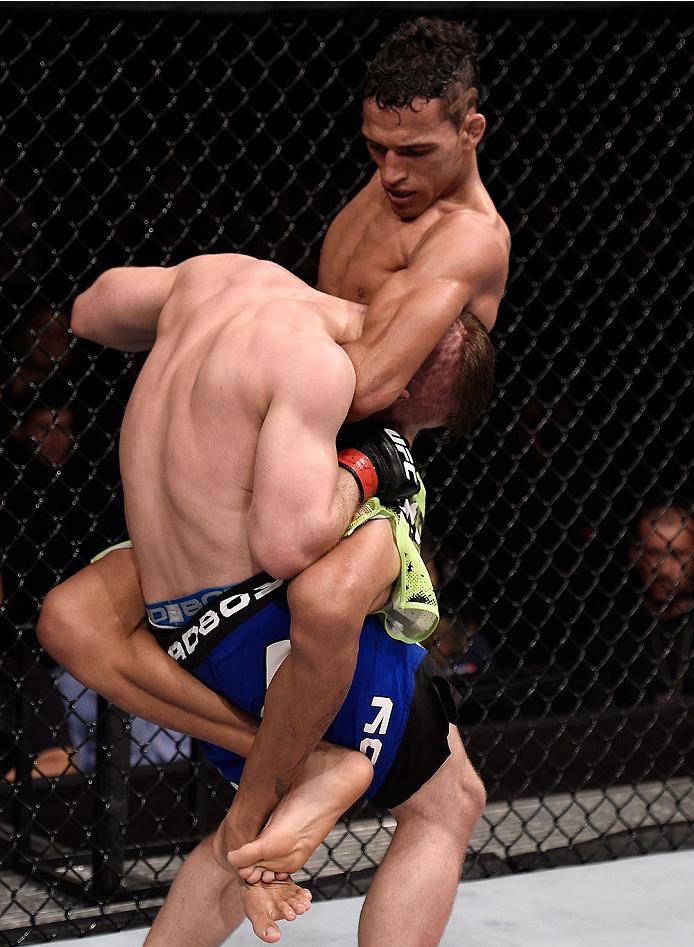 GOIANIA, BRAZIL - MAY 30:  Charles Oliveira attempts to submit Nick Lentz of the United States in their featherweight UFC bout during the UFC Fight Night event at Arena Goiania on May 30, 2015 in Goiania, Brazil.  (Photo by Buda Mendes/Zuffa LLC/Zuffa LLC