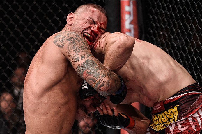 GOIANIA, BRAZIL - MAY 30:  Thiago Alves of Brazil punches Carlos Condit of the United States in their welterweight UFC bout during the UFC Fight Night event at Arena Goiania on May 30, 2015 in Goiania, Brazil.  (Photo by Buda Mendes/Zuffa LLC/Zuffa LLC vi