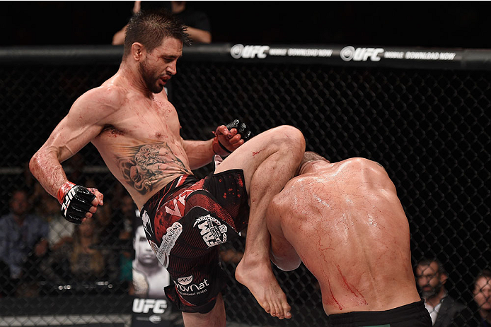 GOIANIA, BRAZIL - MAY 31:  Carlos Condit of the United States kicks Thiago Alves of Brazil in their welterweight UFC bout during the UFC Fight Night event at Arena Goiania on May 30, 2015 in Goiania, Brazil.   (Photo by Buda Mendes/Zuffa LLC/Zuffa LLC via
