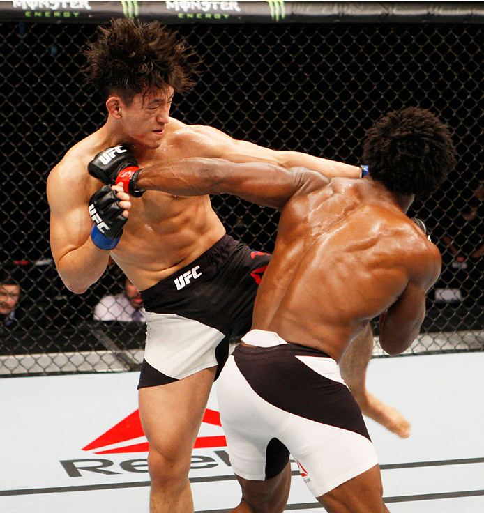 SEOUL, SOUTH KOREA - NOVEMBER 28: (From L to R) Dong Hyun Kim of South Korea  and Dominique Steele of the United States of America exchange strikes  in their lightweight bout during the UFC Fight Night at the Olympic Park Gymnastics Arena on November 28,