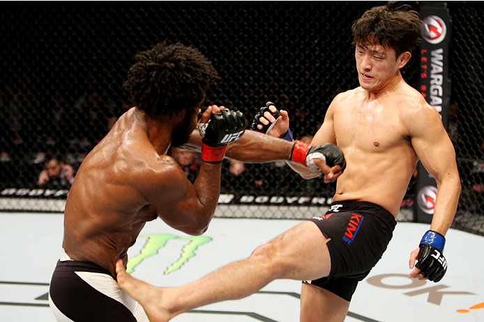 SEOUL, SOUTH KOREA - NOVEMBER 28: Dong Hyun Kim of South Korea kicks Dominique Steele of the United States of America in their lightweight bout during the UFC Fight Night at the Olympic Park Gymnastics Arena on November 28, 2015 in Seoul, South Korea. (Ph