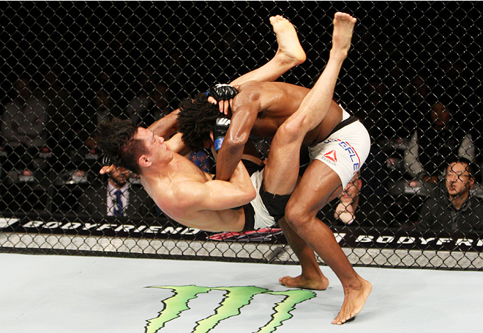 SEOUL, SOUTH KOREA - NOVEMBER 28: Dominique Steele of the United States of America slams Dong Hyun Kim of South Korea which led to a knockout  in their lightweight bout during the UFC Fight Night at the Olympic Park Gymnastics Arena on November 28, 2015 i