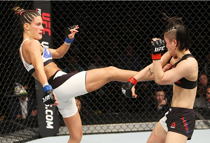 SEOUL, SOUTH KOREA - NOVEMBER 28: Cortney Casey of the United States of America kicks Seohee Ham of South Korea in their  strawweight bout during the UFC Fight Night at the Olympic Park Gymnastics Arena on November 28, 2015 in Seoul, South Korea. (Photo b
