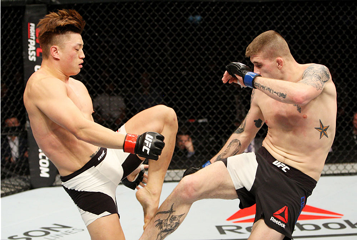 SEOUL, SOUTH KOREA - NOVEMBER 28: Jake Collier of the United States of America kicks Dongi Yang of South Korea in their  middleweight bout during the UFC Fight Night at the Olympic Park Gymnastics Arena on November 28, 2015 in Seoul, South Korea. (Photo b