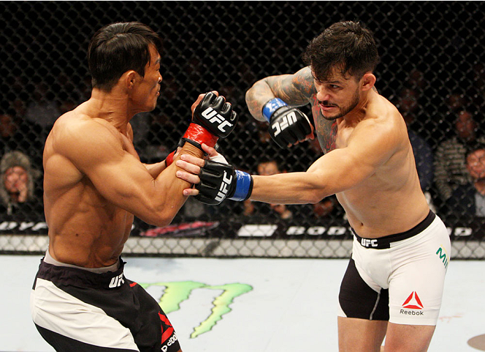 SEOUL, SOUTH KOREA - NOVEMBER 28: Alberto Mina of Brazil throws a punch at Yoshihiro Akiyama of Japan in their  welterweight bout during the UFC Fight Night at the Olympic Park Gymnastics Arena on November 28, 2015 in Seoul, South Korea. (Photo by Mitch V