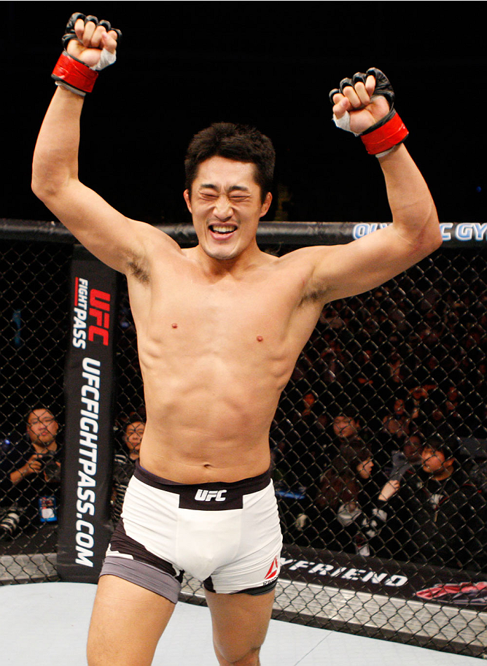 SEOUL, SOUTH KOREA - NOVEMBER 28: Dong Hyun Kim of South Korea celebrates his win over Dominic Waters of the United States of America in their  welterweight bout during the UFC Fight Night at the Olympic Park Gymnastics Arena on November 28, 2015 in Seoul
