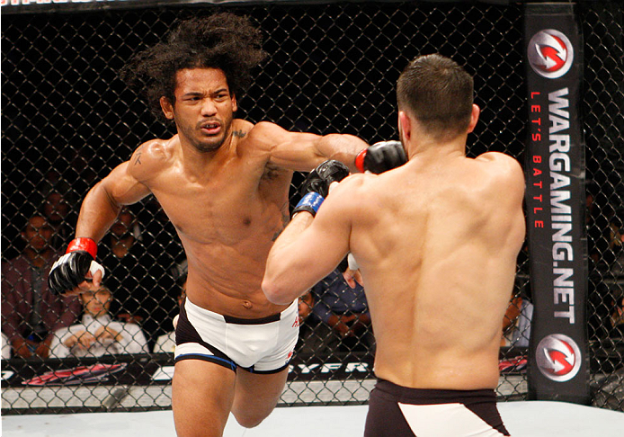 SEOUL, SOUTH KOREA - NOVEMBER 28: Benson Henderson of the United States of America punches Jorge Masvidal of the United States of America  in their welterweight bout during the UFC Fight Night at the Olympic Park Gymnastics Arena on November 28, 2015 in S