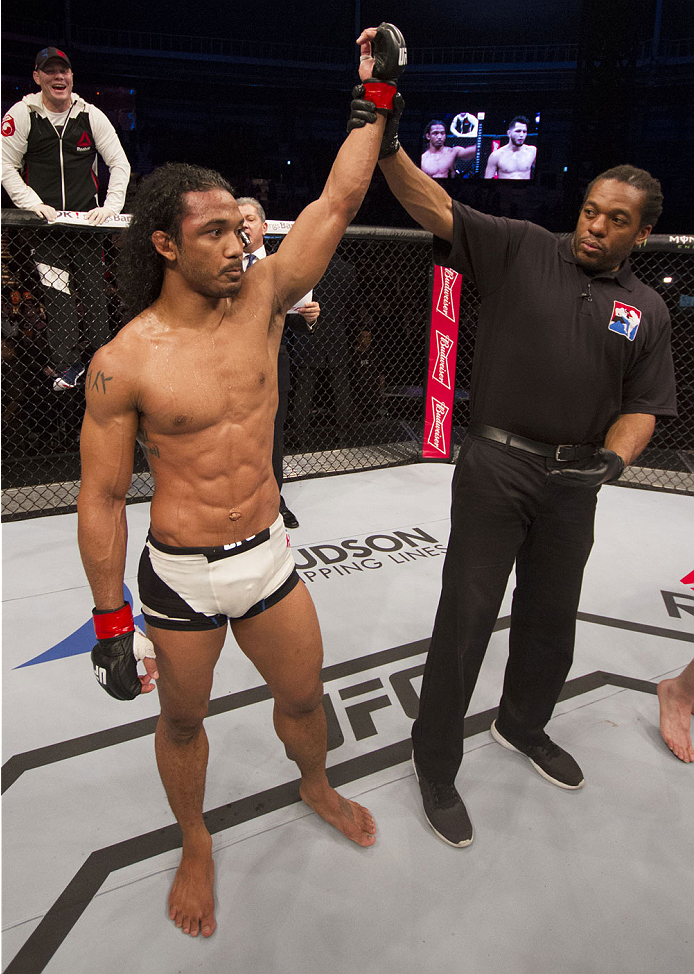 SEOUL, SOUTH KOREA - NOVEMBER 28:  Benson Henderson of the United States of America has his hand raised after a split decision victory over Jorge Masvidal of the United States of America in their welterweight bout during the UFC Fight Night at the Olympic