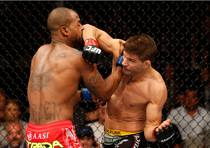 SAN JOSE, CA - JULY 26:  (R-L) Josh Thomson elbows Bobby Green in their lightweight bout during the UFC Fight Night event at SAP Center on July 26, 2014 in San Jose, California.  (Photo by Josh Hedges/Zuffa LLC/Zuffa LLC via Getty Images)