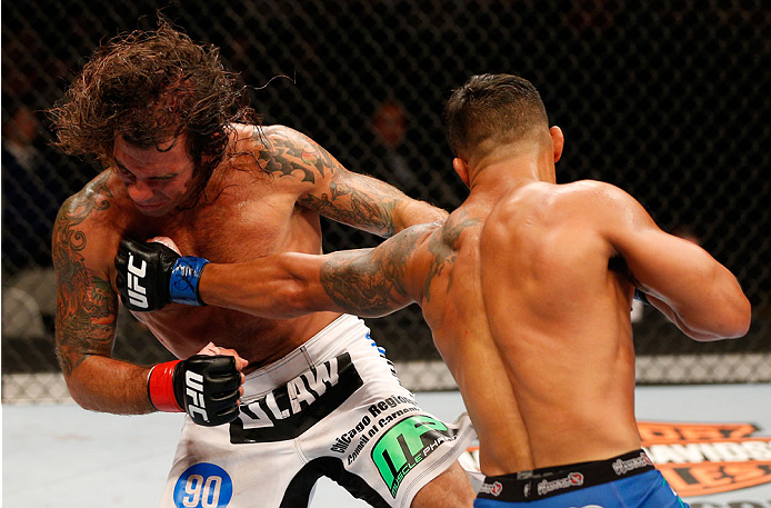 SAN JOSE, CA - JULY 26:  (R-L) Dennis Bermudez punches Clay Guida in their featherweight bout during the UFC Fight Night event at SAP Center on July 26, 2014 in San Jose, California.  (Photo by Josh Hedges/Zuffa LLC/Zuffa LLC via Getty Images)