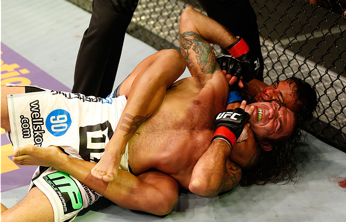SAN JOSE, CA - JULY 26:  (R-L) Dennis Bermudez secures a rear choke submission against Clay Guida in their featherweight bout during the UFC Fight Night event at SAP Center on July 26, 2014 in San Jose, California.  (Photo by Josh Hedges/Zuffa LLC/Zuffa L