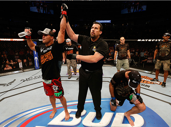 SAN JOSE, CA - JULY 26:  Robbie Lawler (L) celebrates after his unanimous-decision victory over Matt Brown in their welterweight bout during the UFC Fight Night event at SAP Center on July 26, 2014 in San Jose, California.  (Photo by Josh Hedges/Zuffa LLC