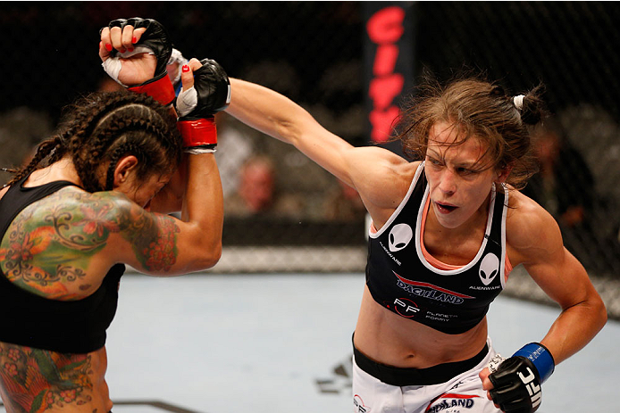 SAN JOSE, CA - JULY 26:  (R-L) Joanna Jedrzejczyk punches Julianna Lima in their womens strawweight bout during the UFC Fight Night event at SAP Center on July 26, 2014 in San Jose, California.  (Photo by Josh Hedges/Zuffa LLC/Zuffa LLC via Getty Images)