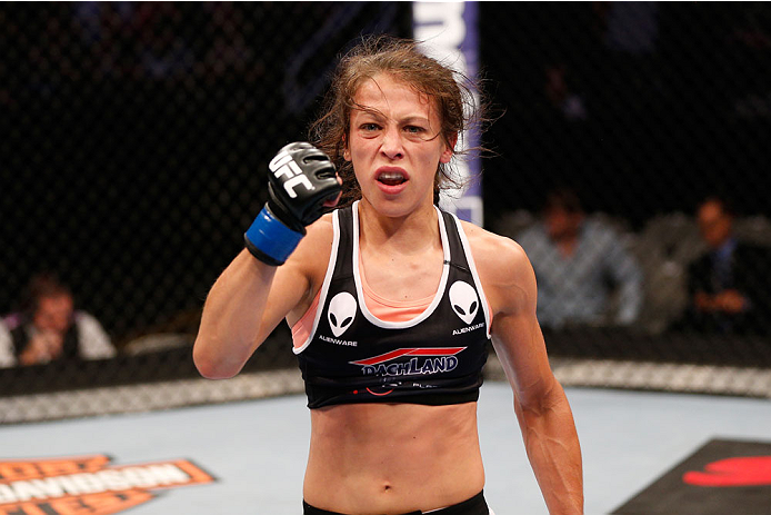 SAN JOSE, CA - JULY 26:  Joanna Jedrzejczyk celebrates after defeating Julianna Lima in their womens strawweight bout during the UFC Fight Night event at SAP Center on July 26, 2014 in San Jose, California.  (Photo by Josh Hedges/Zuffa LLC/Zuffa LLC via G