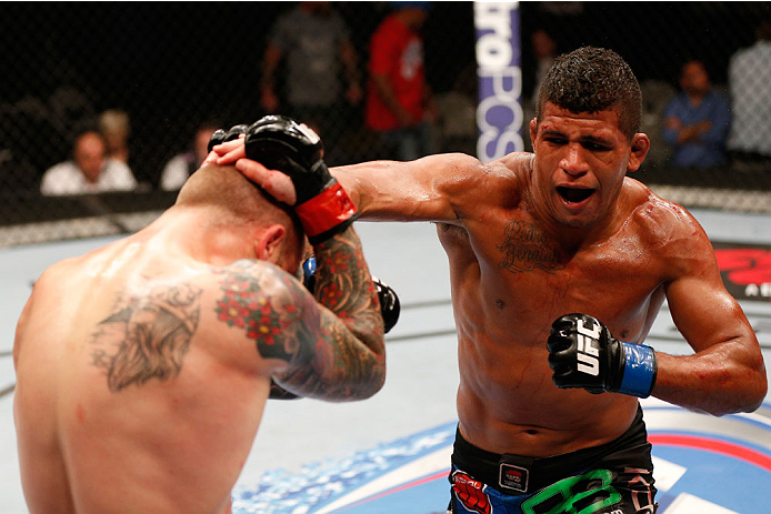 SAN JOSE, CA - JULY 26:  (R-L) Gilbert Burns punches Andreas Stahl in their welterweight bout during the UFC Fight Night event at SAP Center on July 26, 2014 in San Jose, California.  (Photo by Josh Hedges/Zuffa LLC/Zuffa LLC via Getty Images)