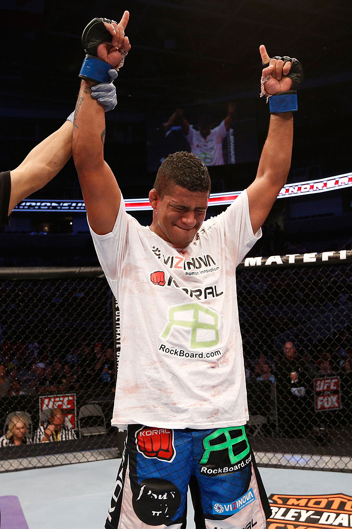 SAN JOSE, CA - JULY 26:  Gilbert Burns celebrates after defeating Andreas Stahl in their welterweight bout during the UFC Fight Night event at SAP Center on July 26, 2014 in San Jose, California.  (Photo by Josh Hedges/Zuffa LLC/Zuffa LLC via Getty Images