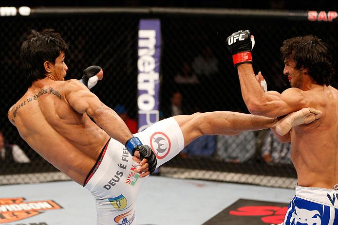 SAN JOSE, CA - JULY 26:  (L-R) Tiago Trator kicks Akbarh Arreola in their lightweight bout during the UFC Fight Night event at SAP Center on July 26, 2014 in San Jose, California.  (Photo by Josh Hedges/Zuffa LLC/Zuffa LLC via Getty Images)