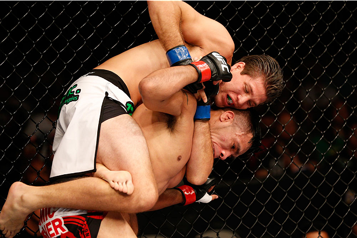 SAN JOSE, CA - JULY 26:  (L-R) Brian Ortega attempts to secure a rear choke submission against Mike De La Torre in their featherweight bout during the UFC Fight Night event at SAP Center on July 26, 2014 in San Jose, California.  (Photo by Josh Hedges/Zuf