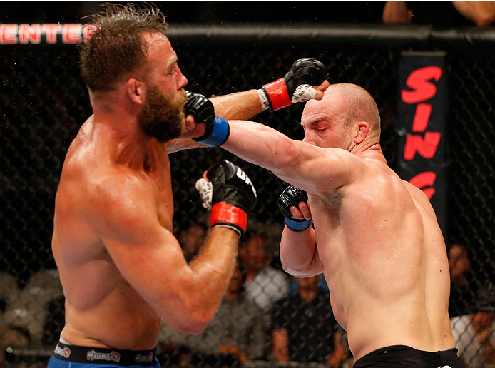 SAN JOSE, CA - JULY 26:  (R-L) Patrick Cummins punches Kyle Kingsbury in their light heavyweight bout during the UFC Fight Night event at SAP Center on July 26, 2014 in San Jose, California.  (Photo by Josh Hedges/Zuffa LLC/Zuffa LLC via Getty Images)