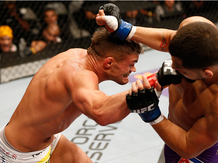 SAN JOSE, CA - JULY 26:  (L-R) Daron Cruickshank punches Jorge Masvidal in their lightweight bout during the UFC Fight Night event at SAP Center on July 26, 2014 in San Jose, California.  (Photo by Josh Hedges/Zuffa LLC/Zuffa LLC via Getty Images)