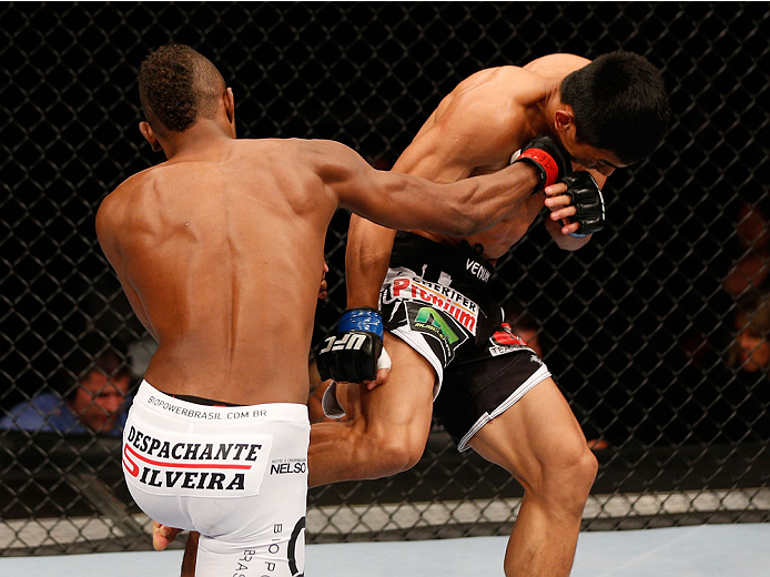 SAO PAULO, BRAZIL - MAY 31: (L-R) Kevin Souza counters a Mark Eddiva kick with a punch in their featherweight fight during the UFC Fight Night event at the Ginasio do Ibirapuera on May 31, 2014 in Sao Paulo, Brazil. (Photo by Josh Hedges/Zuffa LLC/Zuffa L
