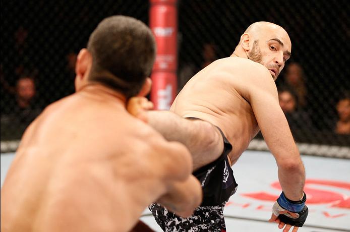 SAO PAULO, BRAZIL - MAY 31:  (R-L) Gasan Umalatov kicks Paulo Thiago in their welterweight fight during the UFC Fight Night event at the Ginasio do Ibirapuera on May 31, 2014 in Sao Paulo, Brazil. (Photo by Josh Hedges/Zuffa LLC/Zuffa LLC via Getty Images