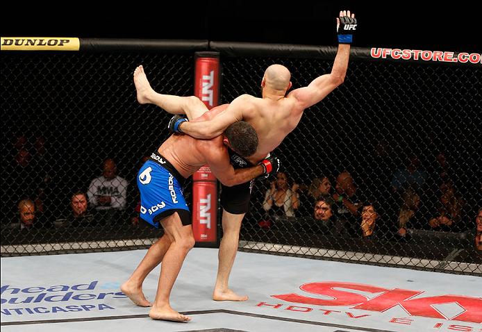 SAO PAULO, BRAZIL - MAY 31:  (L-R) Paulo Thiago takes down Gasan Umalatov in their welterweight fight during the UFC Fight Night event at the Ginasio do Ibirapuera on May 31, 2014 in Sao Paulo, Brazil. (Photo by Josh Hedges/Zuffa LLC/Zuffa LLC via Getty I