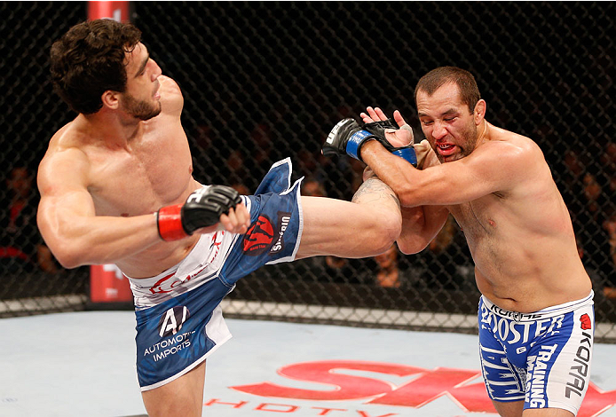 SAO PAULO, BRAZIL - MAY 31: (L-R) Elias Silverio kicks Ernest Chavez in their lightweight fight during the UFC Fight Night event at the Ginasio do Ibirapuera on May 31, 2014 in Sao Paulo, Brazil. (Photo by Josh Hedges/Zuffa LLC/Zuffa LLC via Getty Images)