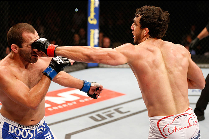 SAO PAULO, BRAZIL - MAY 31: (R-L) Elias Silverio punches Ernest Chavez in their lightweight fight during the UFC Fight Night event at the Ginasio do Ibirapuera on May 31, 2014 in Sao Paulo, Brazil. (Photo by Josh Hedges/Zuffa LLC/Zuffa LLC via Getty Image