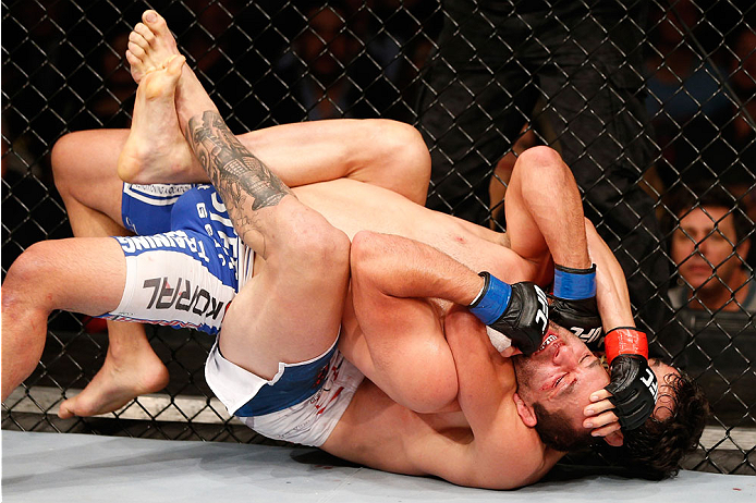 SAO PAULO, BRAZIL - MAY 31: (R-L) Elias Silverio secures a rear choke submission against Ernest Chavez in their lightweight fight during the UFC Fight Night event at the Ginasio do Ibirapuera on May 31, 2014 in Sao Paulo, Brazil. (Photo by Josh Hedges/Zuf
