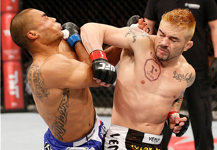"""SAO PAULO, BRAZIL - MAY 31: (R-L) Rony """"Jason"""" Mariano-Bazzera lands a spinning back elbow against Robbie Peralta in their featherweight fight during the UFC Fight Night event at the Ginasio do Ibirapuera on May 31, 2014 in Sao Paulo, Brazil. (Photo by Jo"""