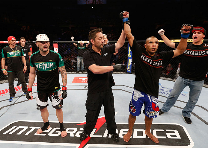 """SAO PAULO, BRAZIL - MAY 31: Robbie Peralta reacts after his split decision victory over Rony """"Jason"""" Mariano-Bazzera in their featherweight fight during the UFC Fight Night event at the Ginasio do Ibirapuera on May 31, 2014 in Sao Paulo, Brazil. (Photo by"""