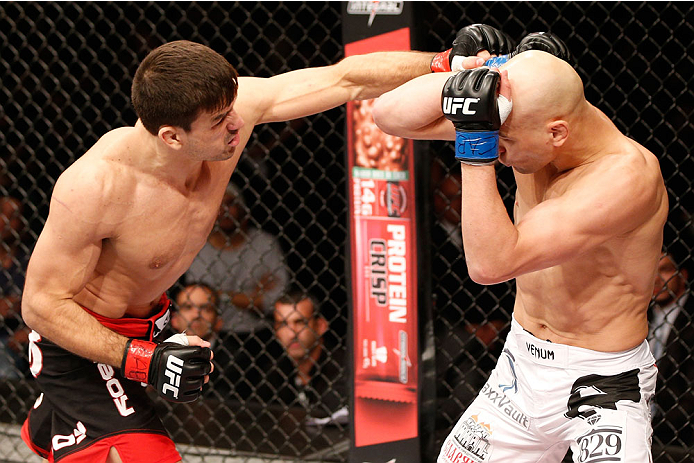 SAO PAULO, BRAZIL - MAY 31: (L-R) Demian Maia punches Alexander Yakovlev in their welterweight fight during the UFC Fight Night event at the Ginasio do Ibirapuera on May 31, 2014 in Sao Paulo, Brazil. (Photo by Josh Hedges/Zuffa LLC/Zuffa LLC via Getty Im