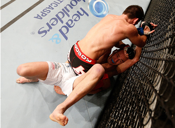 SAO PAULO, BRAZIL - MAY 31: Demian Maia (top) punches Alexander Yakovlev in their welterweight fight during the UFC Fight Night event at the Ginasio do Ibirapuera on May 31, 2014 in Sao Paulo, Brazil. (Photo by Josh Hedges/Zuffa LLC/Zuffa LLC via Getty Im