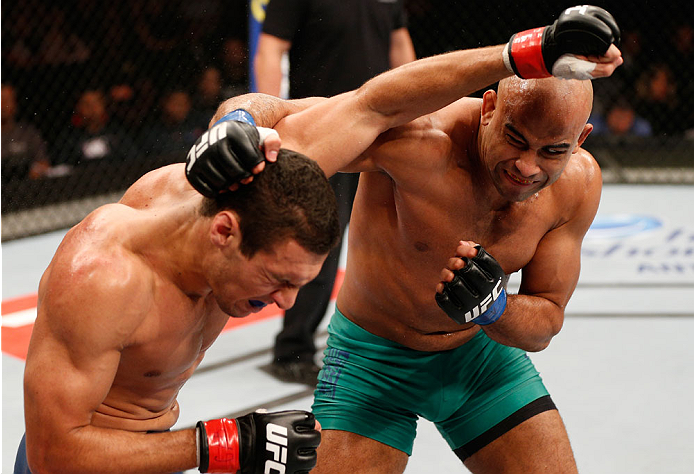 SAO PAULO, BRAZIL - MAY 31:  (R-L) Warlley Alves punches Marcio Alexandre in their middleweight fight during the UFC Fight Night event at the Ginasio do Ibirapuera on May 31, 2014 in Sao Paulo, Brazil. (Photo by Josh Hedges/Zuffa LLC/Zuffa LLC via Getty I