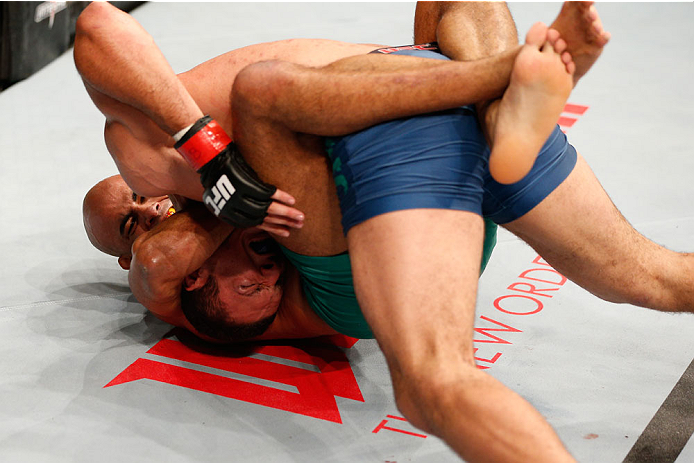 SAO PAULO, BRAZIL - MAY 31:  (L-R) Warlley Alves secures a guillotine choke submission against Marcio Alexandre in their middleweight fight during the UFC Fight Night event at the Ginasio do Ibirapuera on May 31, 2014 in Sao Paulo, Brazil. (Photo by Josh